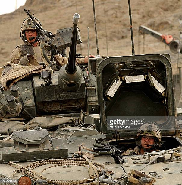 Canadian soldiers with the NATOled International Security Assistance Force set on the top of their tank as they prepare to go on a joint foot Afghan...