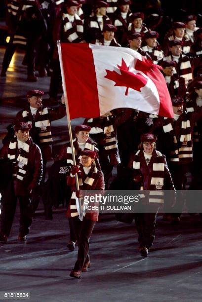 Canadian speed skating athlete Catriona Lemay Doan holds the national flag upon the delegation arrival 08 February 2002 during the opening ceremonies...