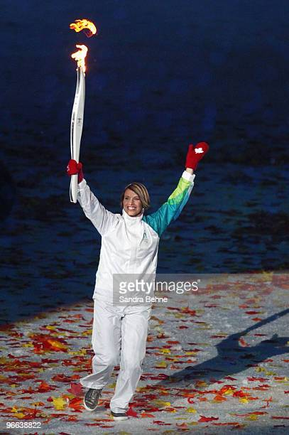 Canadian Speedskater Catriona Le May Doan carries the Olympic torch during the Opening Ceremony of the 2010 Vancouver Winter Olympics at BC Place on...