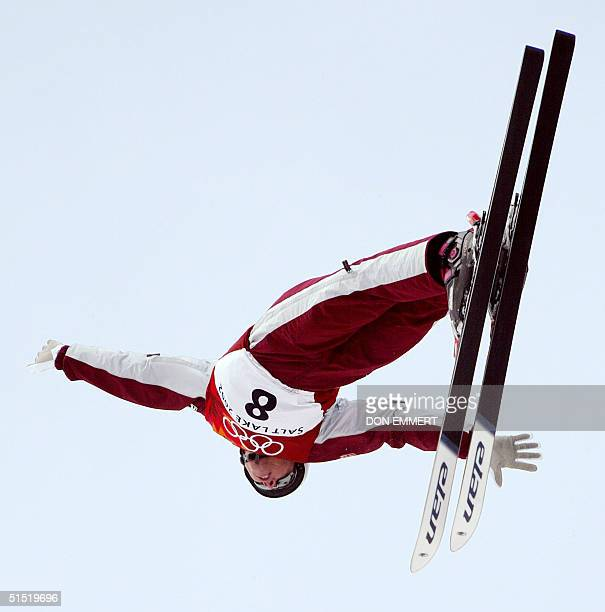 Canadian Steve Omischl performs his jump during the men's Aerials final for the Winter Olympics 19 February 2002 at Deer Valley Resort. AFP PHOTO/DON...