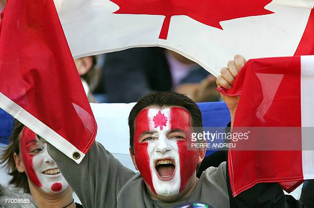 A Canadian supporter waves his national flag prior to the rugby union World Cup group B match Canada vs Japan 25 September 2007 at the ChabanDelmas...
