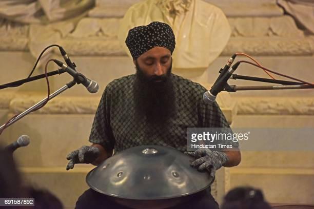 Canadian tabla fusion artist Gurpreet Chana plays the hang at Bhau Daji Lad Museum at Byculla on June 1 2017 in Mumbai India Chana first encountered...