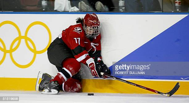 Canadian team captain Cassie Campbell handles the puck during the Women's Ice Hockey semifinal against Finland at the XIX Winter Olympics 19 February...