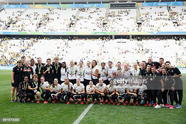Canadian team celebrates with their medals following victory during the Women's Olympic Football Bronze Medal match between Brazil and Canada at...