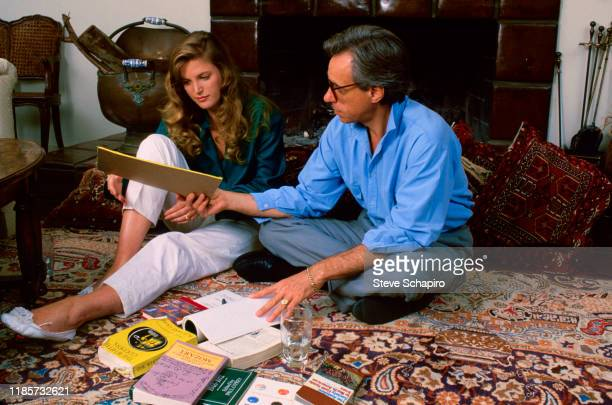 Canadian teenager Louise Hoogstraten and American film director Peter Bogdanovich sit on the floor as they talk together Los Angeles California 1985...