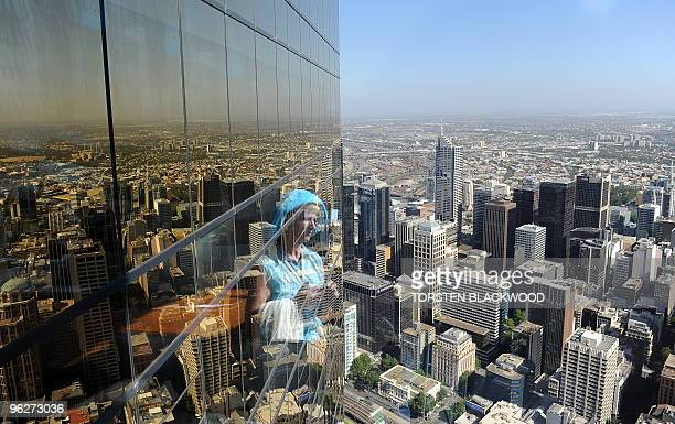 Canadian tourist Bernice Griffiths is reflected in the 24carat gold tinted windows on the 88th floor of the Eureka Tower the world's tallest solely...