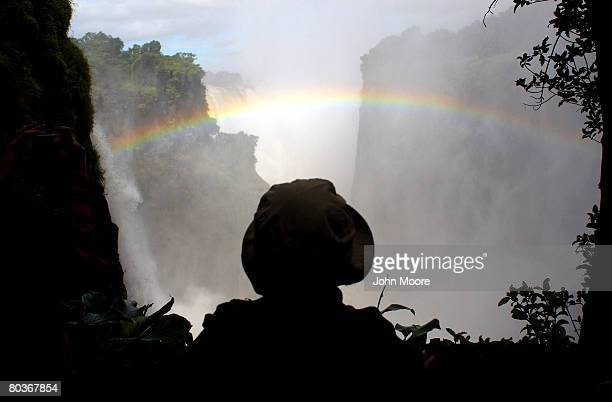 Canadian tourist takes in the scene as the Zambezi River plunges 420 feet March 17, 2008 at Victoria Falls, Zimbabwe. Considered one of the world's...