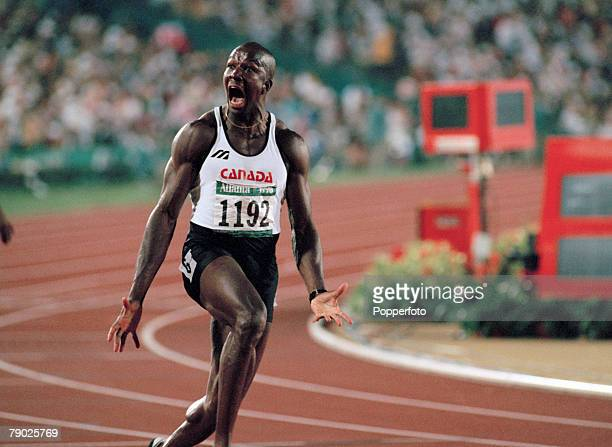 Canadian track and field athlete Donovan Bailey celebrates after crossing the finish line in first place in a world record time of 984 seconds to win...