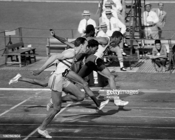 Canadian track and field runner Harry Jerome winning the quarterfinals at the 1960 Summer Olympics followed by British runner Peter Radford Kenyan...