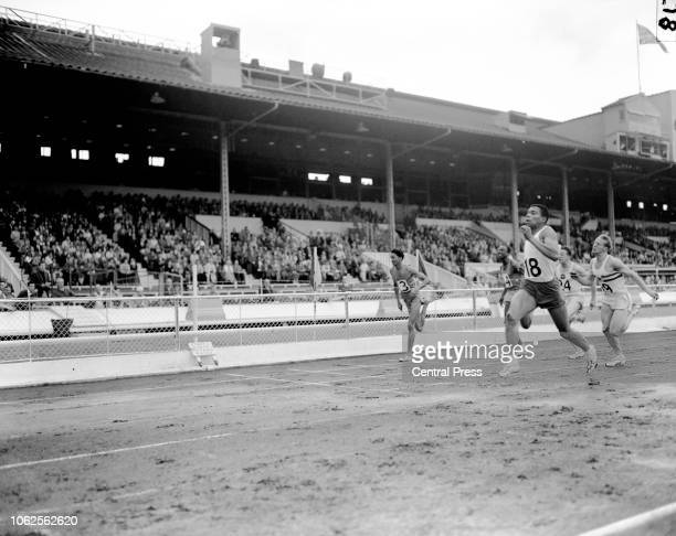 Canadian track and field runner Harry Jerome winning the men's 100 yards at the he Amateur Athletics Association Championships followed by Kenyan...