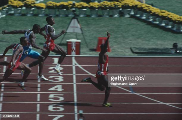Canadian track athlete Ben Johnson crosses the finish line in first place to win the gold medal in the final of the Men's 100 metres event, with Carl...