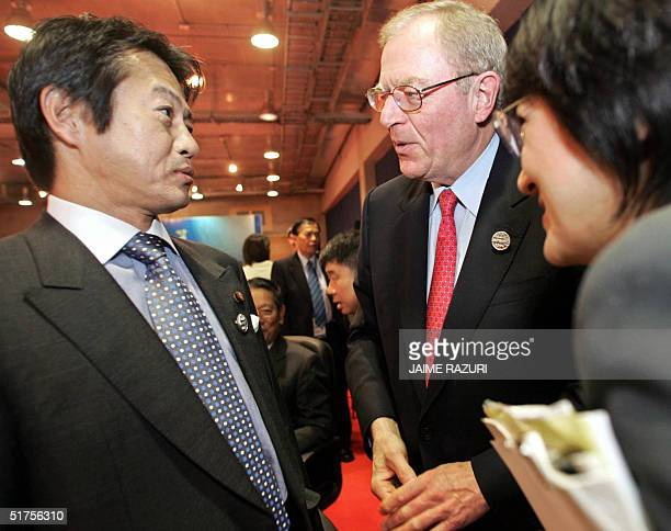 Canadian Trade Minister, James Scott Peterson chats with his Japanesse counterpart, Shoichi Nakagawa , before the opening of the First Meeting of...