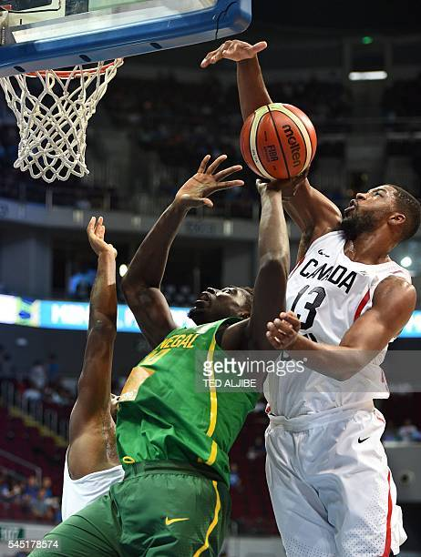 Canadian Tristan Thompson blocks a layup by Cheik Mbodj of Senegal during their 2016 FIBA Olympic men's qualifying basketball tournament in Manila on...