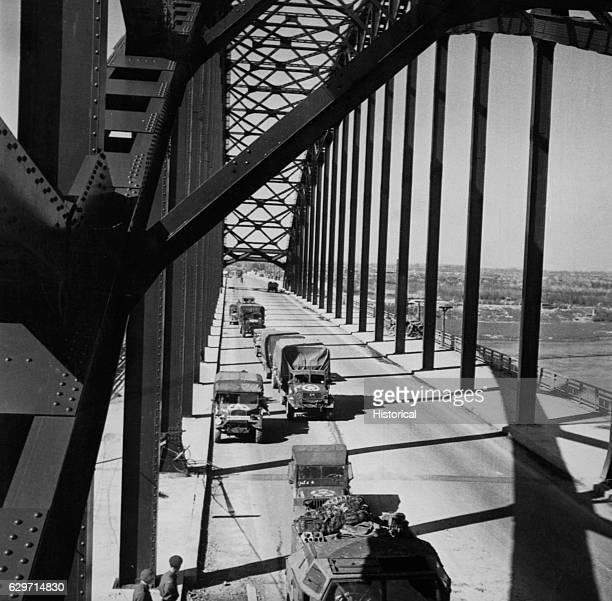 "Canadian troops finally roll over the ""bridge too far,"" the bridge at Arnhem, Netherlands."