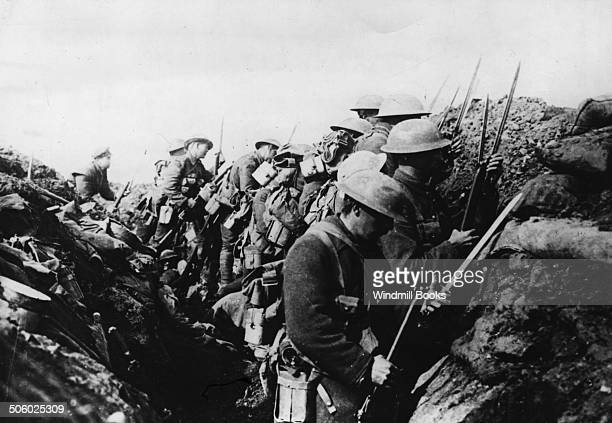 Canadian troops fixing bayonets previous to a raid on the enemy lines Somme Area October 1916 British Front France General Battle Somme