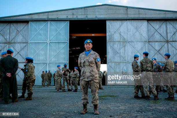 Canadian UN Peacekeeper Cpt Soo Choi poses for a picture prior to a Peace Medals handing ceremony at the old Nicosia airport in the UN Buffer Zone on...