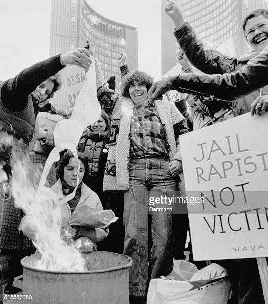 Canadian women marked International Women's Day across the nation Here at Toronto City Hall they burned a bra and protested against rape abortion and...