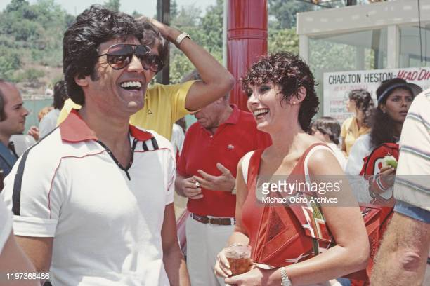 CanadianAmerican actress and writer Beverly Adams Sassoon the former wife of hairstylist Vidal Sassoon with actor Erik Estrada at a Charlton Heston...
