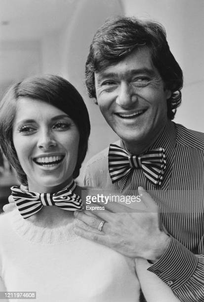 CanadianAmerican actress Beverly Adams and her husband BritishAmerican hairstylist Vidal Sassoon both smiling and wearing matching striped bow ties...
