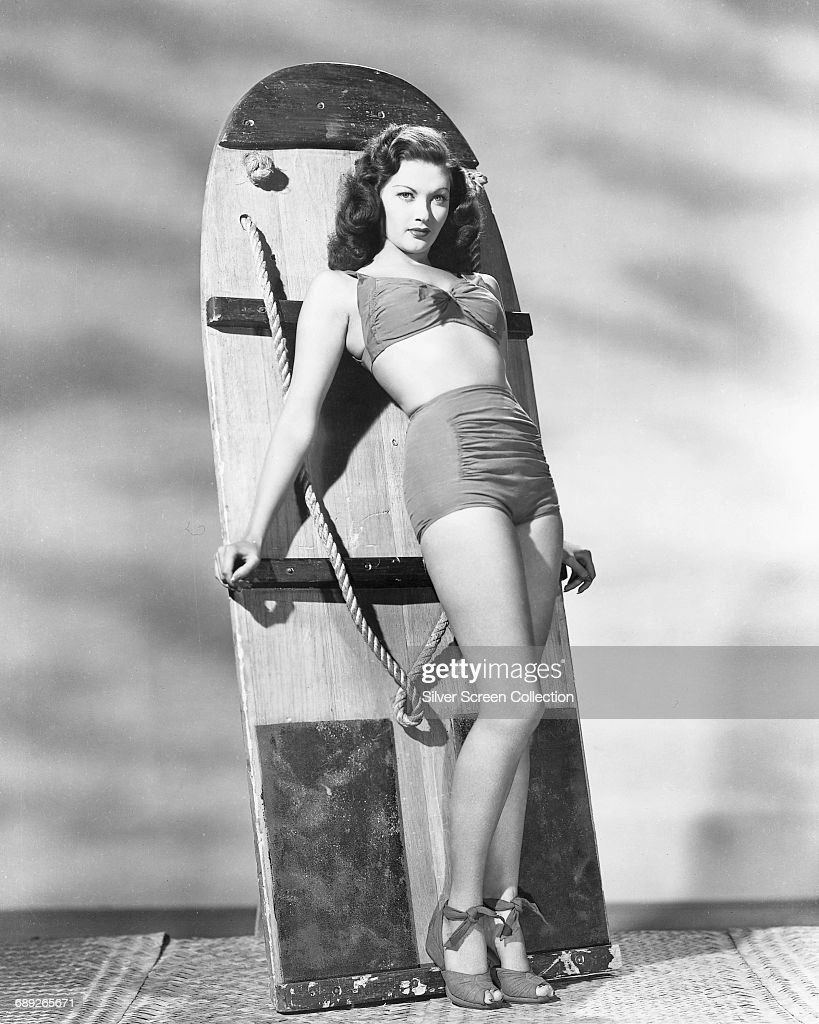 Canadian-American actress Yvonne De Carlo (1922 - 2007) leaning on an aquaplane or wakeboard, circa 1955.