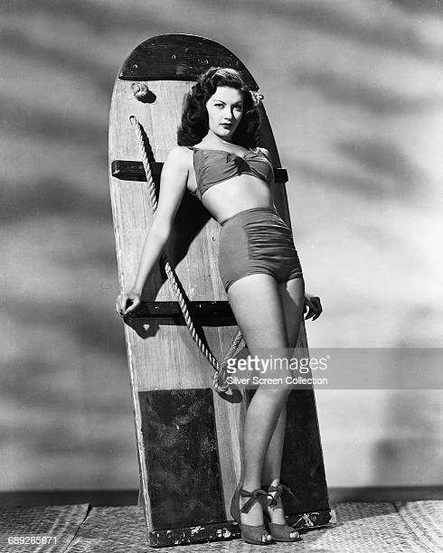 CanadianAmerican actress Yvonne De Carlo leaning on an aquaplane or wakeboard circa 1955