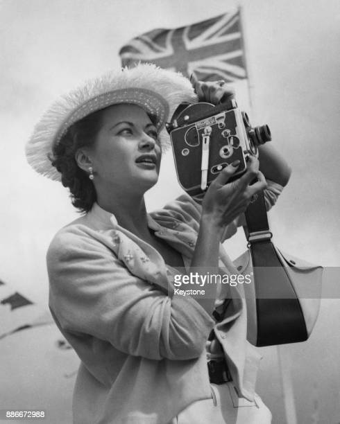 CanadianAmerican actress Yvonne De Carlo tries to film Princess Margaret during a visit to the Bahamas 2nd March 1955 The actress did not have a pass...