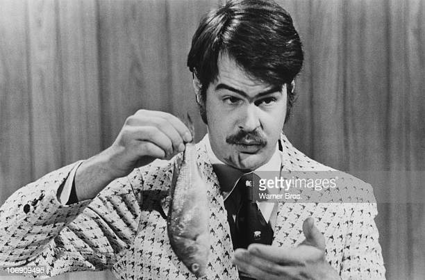 CanadianAmerican comedian Dan Aykroyd prepares to demonstrate the 'Super BassOMatic' on a sketch from the TV comedy show 'Saturday Night Live' 1976