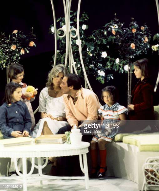 Canadian-American singer Paul Anka and his wife Anne de Zogheb sit with four of their daughters during a photo shoot circa 1970's.