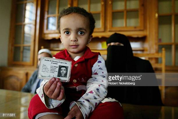 Canadian-Arab Sofia Khadr holds an identity card of her missing grandfather, Ahmed Said Khadr , at a house March 3, 2004 in Islamabad, Pakistan....