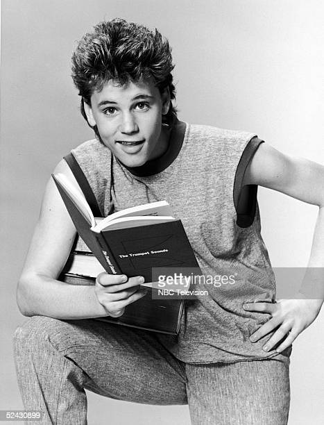 Canadianborn actor Corey Haim in character as a college student in a promotional portrait for the television series 'Roomies' 1986 He holds open a...