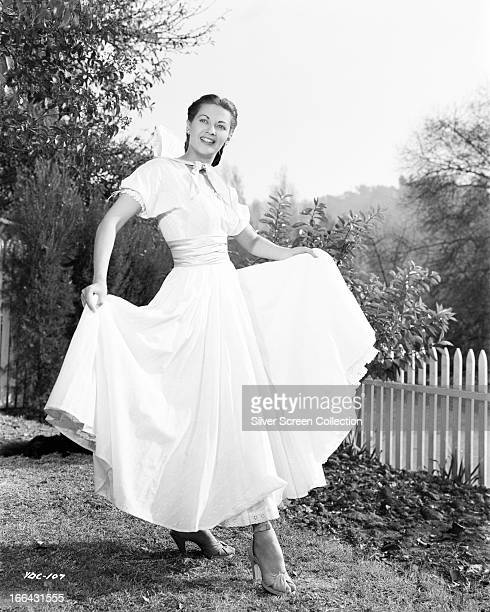 Canadianborn American actress Yvonne De Carlo in a fulllength white day dress circa 1950