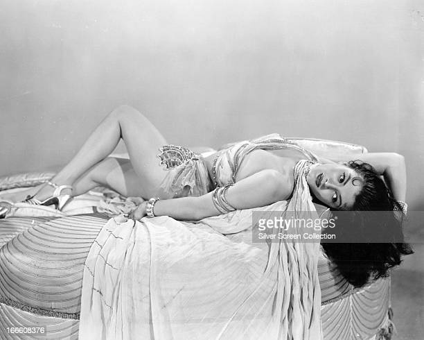 Canadianborn American actress Yvonne De Carlo reclining in an exotic costume circa 1945