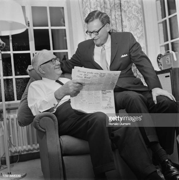 Canadian-born British newspaper proprietor Lord Roy Thomson and his son Kenneth Thomson add 'The Times' to their publishing empire, 30th September...