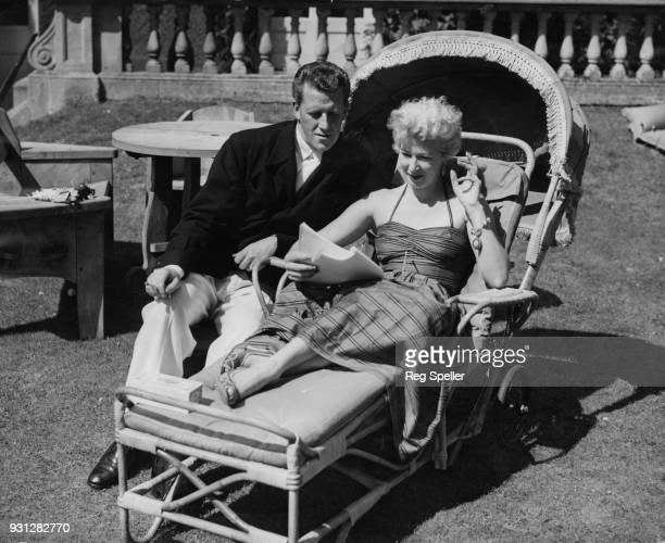 Canadianborn broadcaster Bernard Braden and his wife actress Barbara Kelly read through a script at their home in Shepperton England 18th August 1953