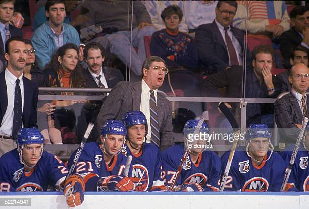 Canadianborn coach of the New York Islanders Al Arbour heads his teams bench during a road game at Madison Square Garden New York New York October...