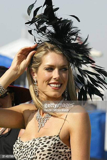 Canadianborn model author and judge of Dubai World Cup 'hats competition' Tara Moss displays her own headdress at the world's richest horse race 27...