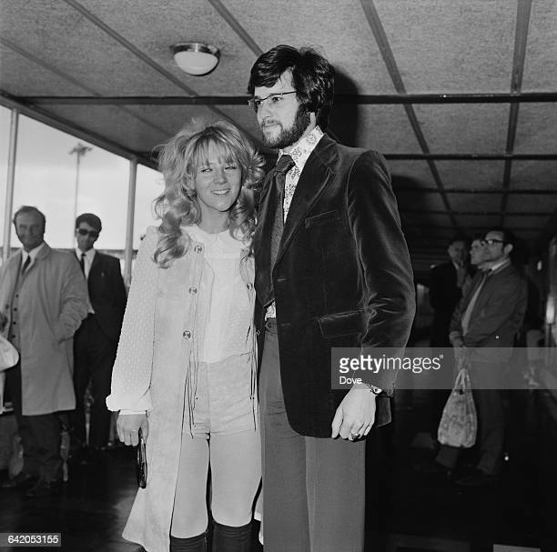 Canadian-born veterinarian Bruce Fogle and his wife, English actress Julia Foster at London Airport, UK, 29th May 1971.