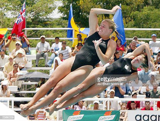Canadians Blythe Hartley and Emillie Heymans flip during the Women's Synchro 3m diving competition to win the gold medal at the XIV Pan American...