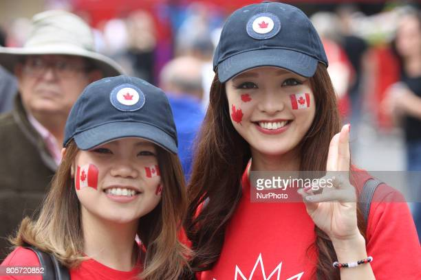 Canadians celebrate Canada Day and the 150th birthday of Canada at YongeDundas Square in downtown Toronto Ontario Canada on July 01 2017