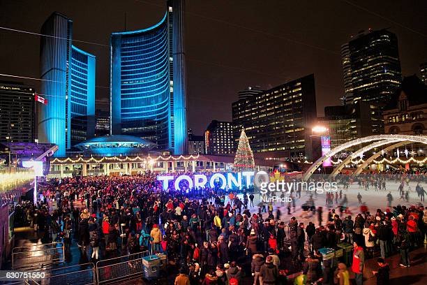 Canadians celebrate during New Years Eve while awaiting the countdown to midnight at Nathan Philips Square in Toronto, Ontario, Canada, on December...