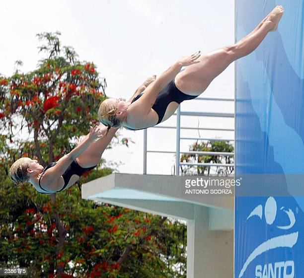 Canadians Emillie Heymans and Blythe Hartley jump during the Women's Synchro 3m diving competition to win the gold medal at the XIV Pan American...