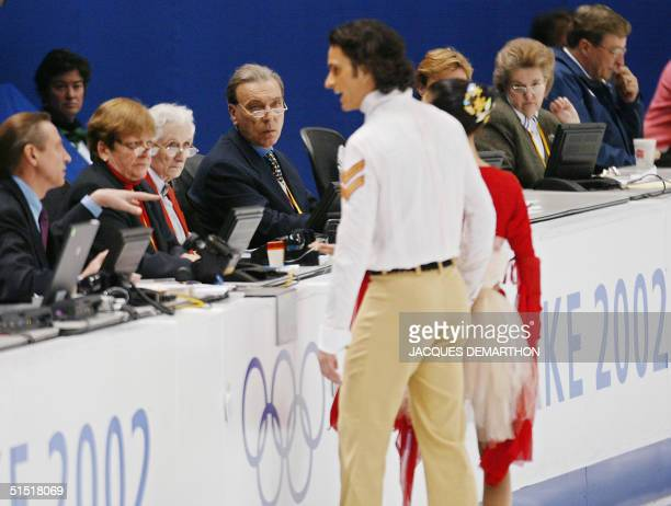 Canadians Marie-France Dubreuil and Patrice Lauzon talk with the judges after her costume became entangled with his shirt during their free dance...