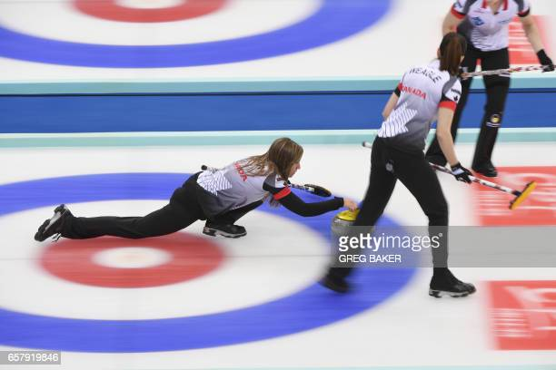 Canadian's Rachel Homan releases the stone as teammates Lisa Weagle and Joanne Courtney look on during the gold medal match against Russia at the...