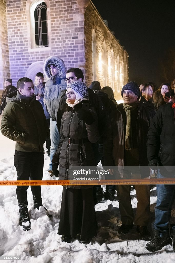 Canadians stand near the Islamic cultural center of Quebec after a shooting occurred in the mosque in Quebec, Canada on January 29, 2017. Five people are dead and a number of others wounded in a shooting at a mosque in Quebec City, the facility's president told media late Sunday.