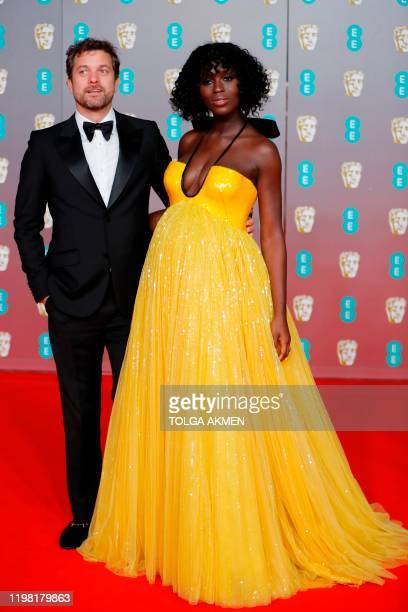 CanadianUS actor Joshua Jackson and his wife British actress Jodie Turner Smith pose on the red carpet upon arrival at the BAFTA British Academy Film...