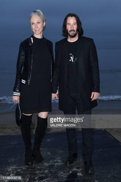 CanadianUS actor Keanu Reeves and US artist Alexandra Grant arrive for the Saint Laurent Men's SpringSummer 2020 runway show in Malibu California on...