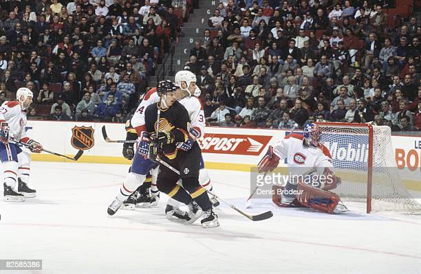 Canadiens defenceman Peter Popovic ties up incoming attacker after a Vancouver scoring chance on goaltender Jocelyn Thibault in a game at the Molson...