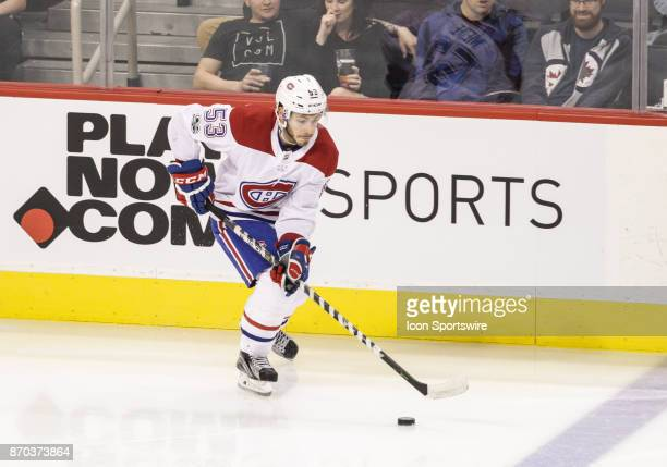 Canadiens defenseman Victor Mete skates with the puck during the NHL game between the Winnipeg Jets and the Montreal Canadiens on November 04 2017 at...
