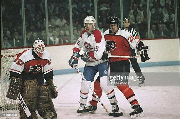 Canadiens forward Bobby Smith jockeys for position against Flyers defenceman Kjell Samuelsson in front of goaltender Ron Hextall at the Montreal...