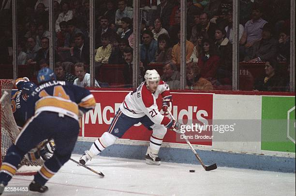 Canadiens forward Guy Carbonneau carries the puck against St Louis opponents at the Montreal Forum during the 198788 season